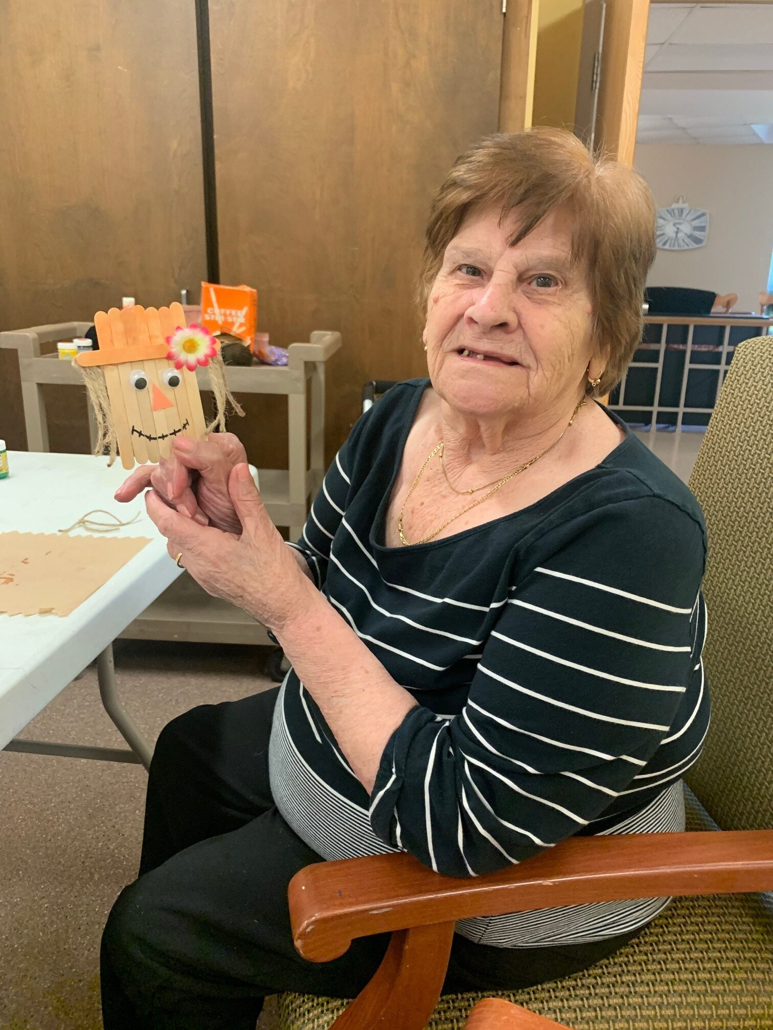 A resident at Fiddick's in Petrolia shows off a fall craft