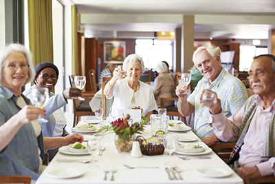 A group of older adults enjoying a luncheon together