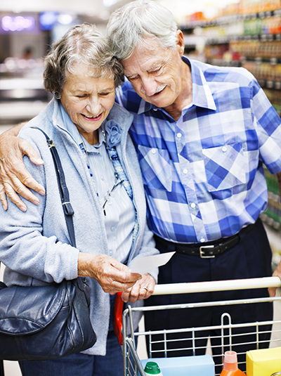 Older man and woman shopping