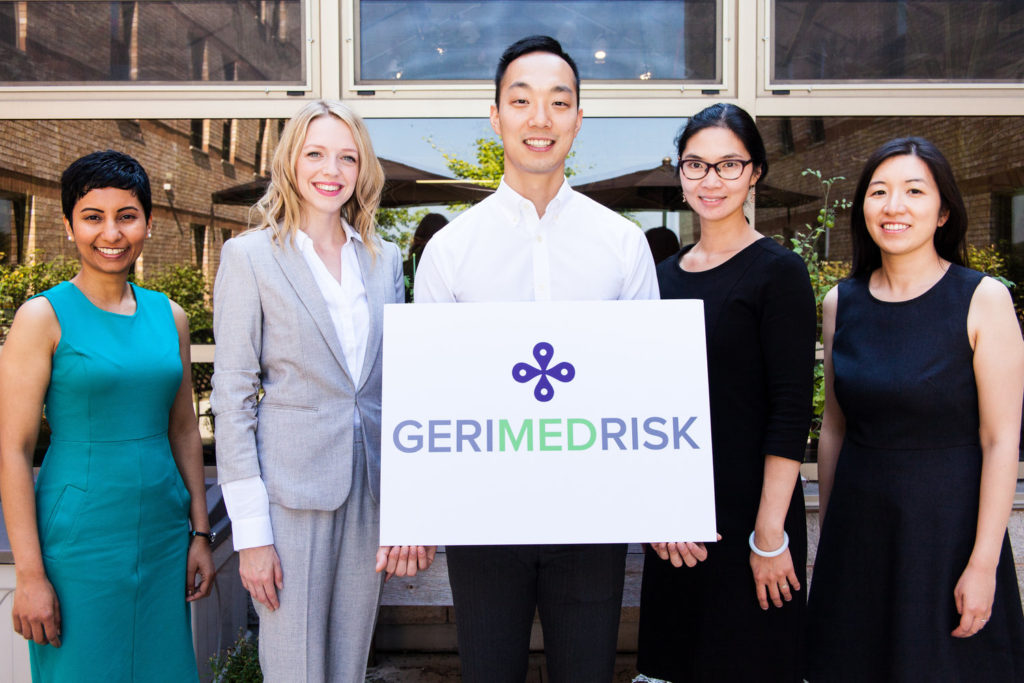 Photo of the GeriMedRisk team holding the GeriMedRisk sign
