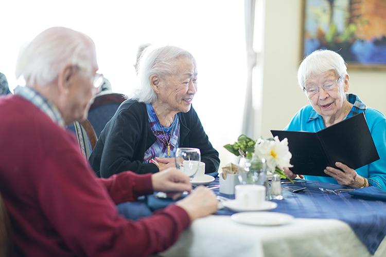 Senior adults having dinner
