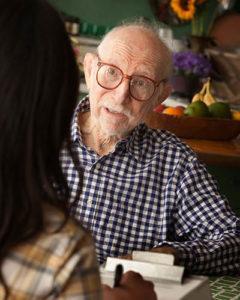 Older man talking with someone