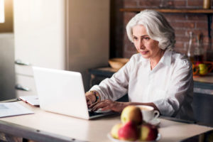 Woman looking at an open laptop