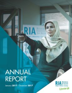 Cover photo of annual report showing a student testing virtual reality