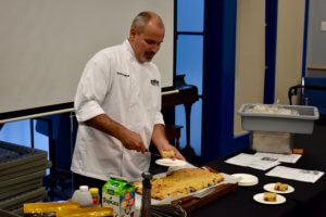 Chef Kevin Hughes cooking at Bean Event