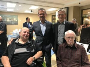 Retired astronaut Chris Hadfield with RIA's Richard Hughson and Village at University Gates residents Phil and George