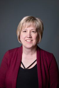 Head shot of Carrie McAiney