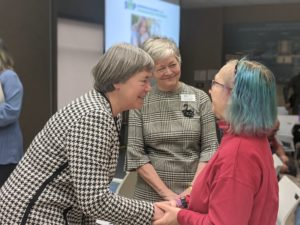 The Honourable Deb Schulte, Minister of Seniors speaks to SIIP Community Advisory Board member Kathleen Vanderlinden and Josie d'Avernas, Executive Director – RIA