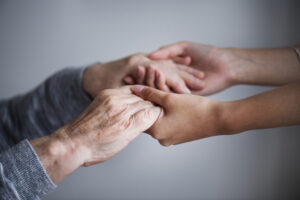 Two sets of hands reach out to each other