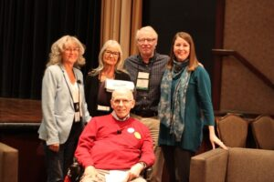 David Kent (seated in front) pictured with fellow panellists at the 2018 Walk with Me conference in Niagara Falls, Ontario.