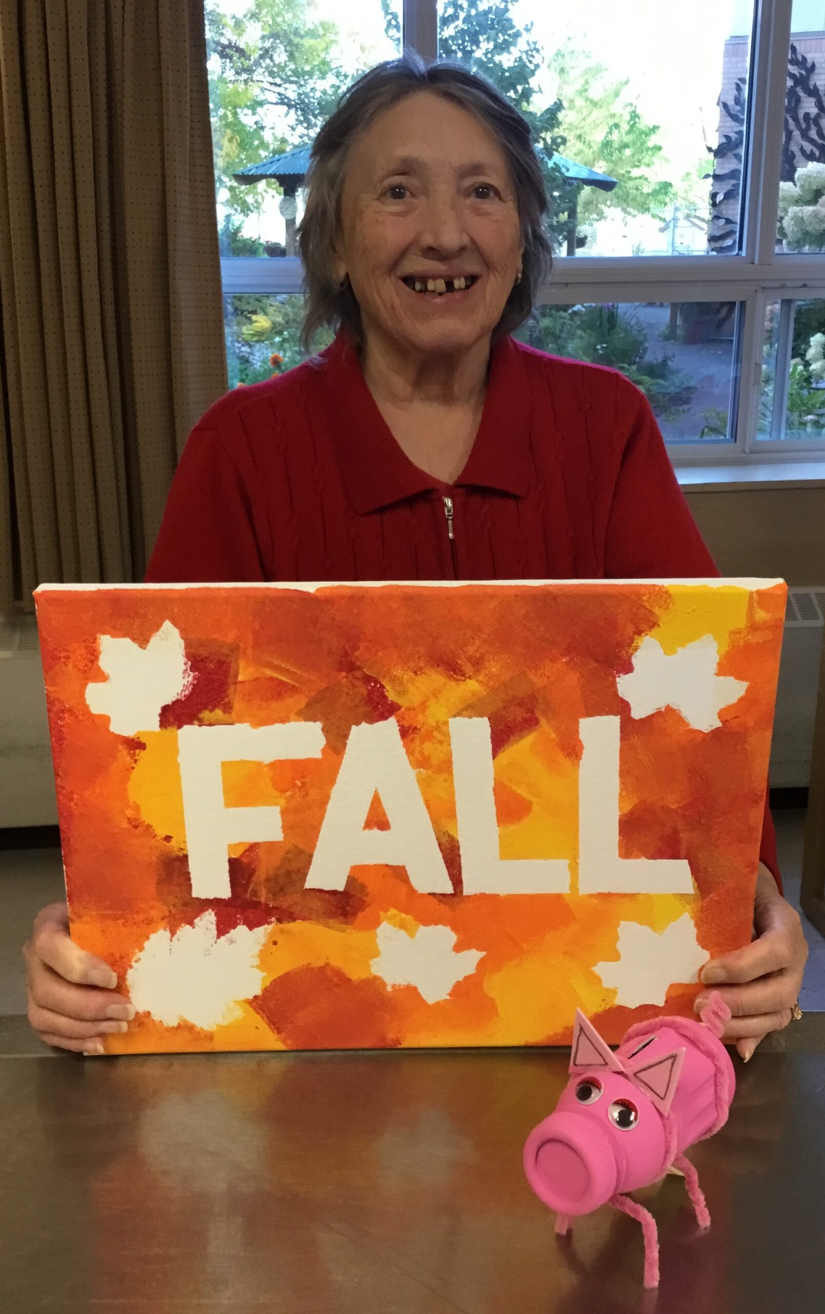 A resident showing off their fall artwork