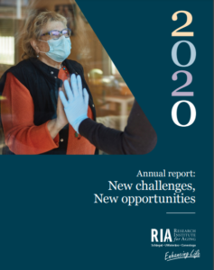 Annual report 2020 cover image showing an older person masked behind glass hold out their hand to an individual on the other side of the glass